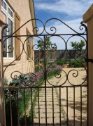 wrought iron gate, rusty gate, old farm gate, french potager garden, kitchen garden, french potager garden at Lavender and Thyme Cottage Pisa Moorings Pisa Central Otago, New Zealand